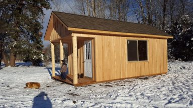 winter and log cabin shed